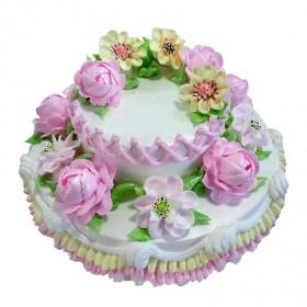 Двухъярусный свадебный торт с множеством цветом