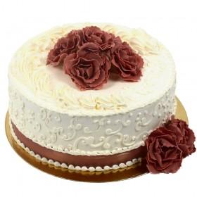 Белый одноярусный свадебный торт, украшенный темными цветами