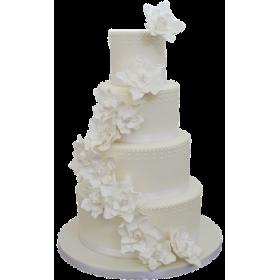 Белый четырехъярусный свадебный торт с цветами