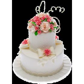 Белый двухъярусный свадебный торт с яркими цветами