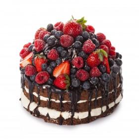 Открытый торт бисквитный украшен ассорти из фруктов