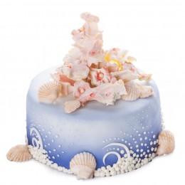 Торт синего цвета, украшенный фигуркой кораллов и разных ракушек из мастики